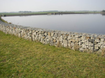 A Gabion wall is used to retain ground at a river bank